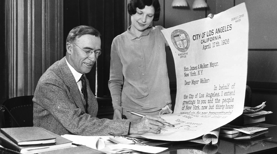 Los Angeles mayor George E. Cryer signing an oversized letter to the mayor of New York City via  USC Libraries