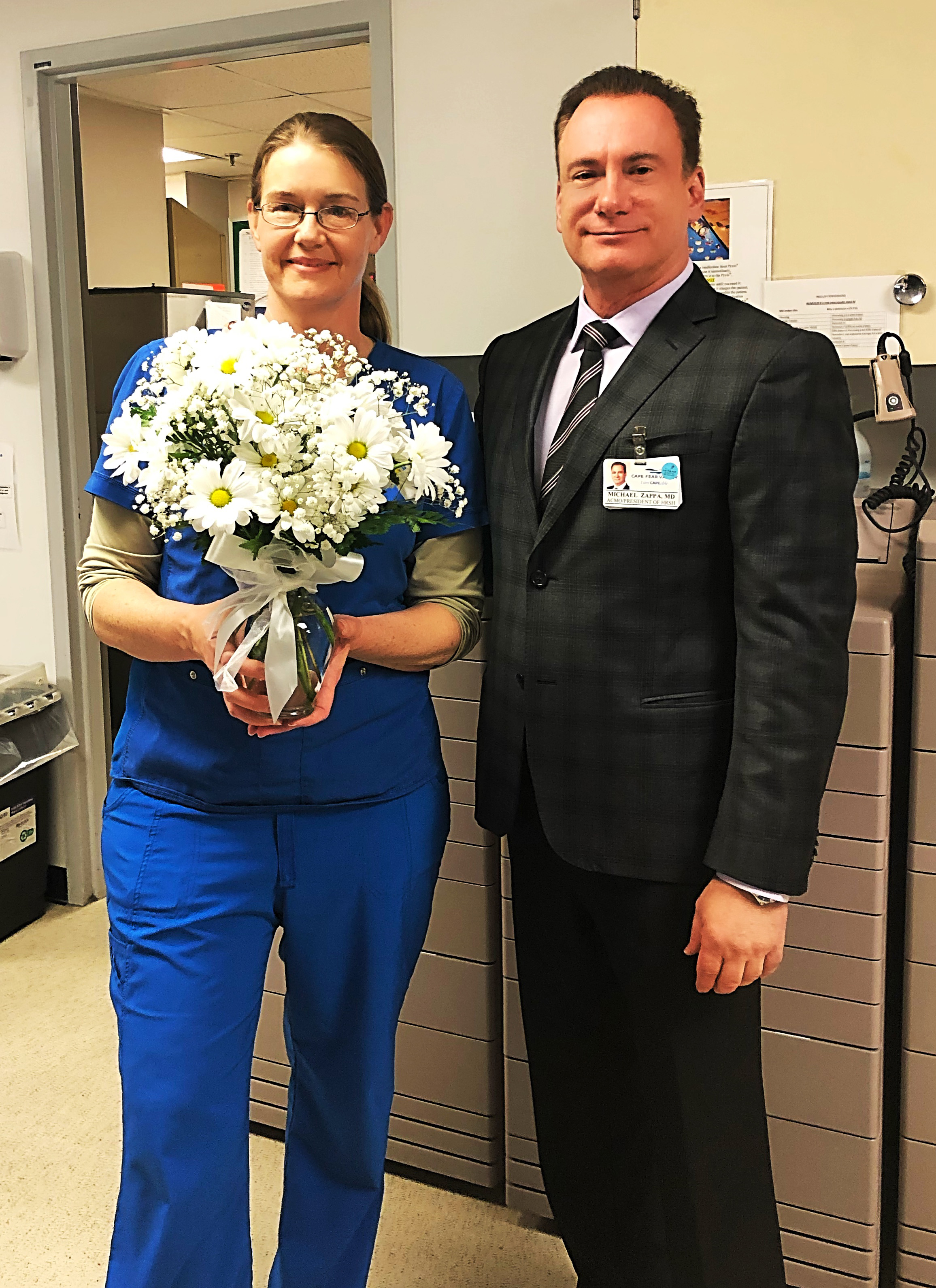 Mary Maset, RN with Dr. Michael Zappa as she receives the DAISY Award.