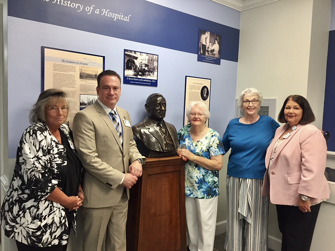Dr. Zappa, current president of HRSH proudly stands next to the bust of the hospital founder and first president Dr. Highsmith.