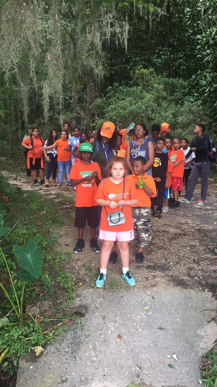 Scholars on a nature trail hike