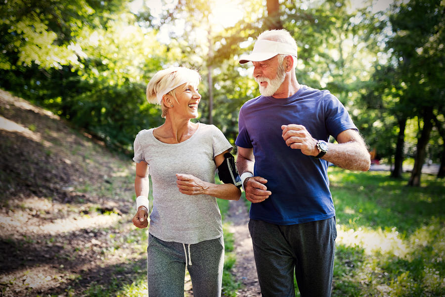 Copy of Senior Couple Jogging And Running Outdoors In Nature
