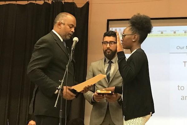 Alexsas Misoka being sworn into the Jersey City school board by the board's president, Sudhan Thomas (left) and board member Mussab Ali. (Courtesy of Alexsas Misoka)