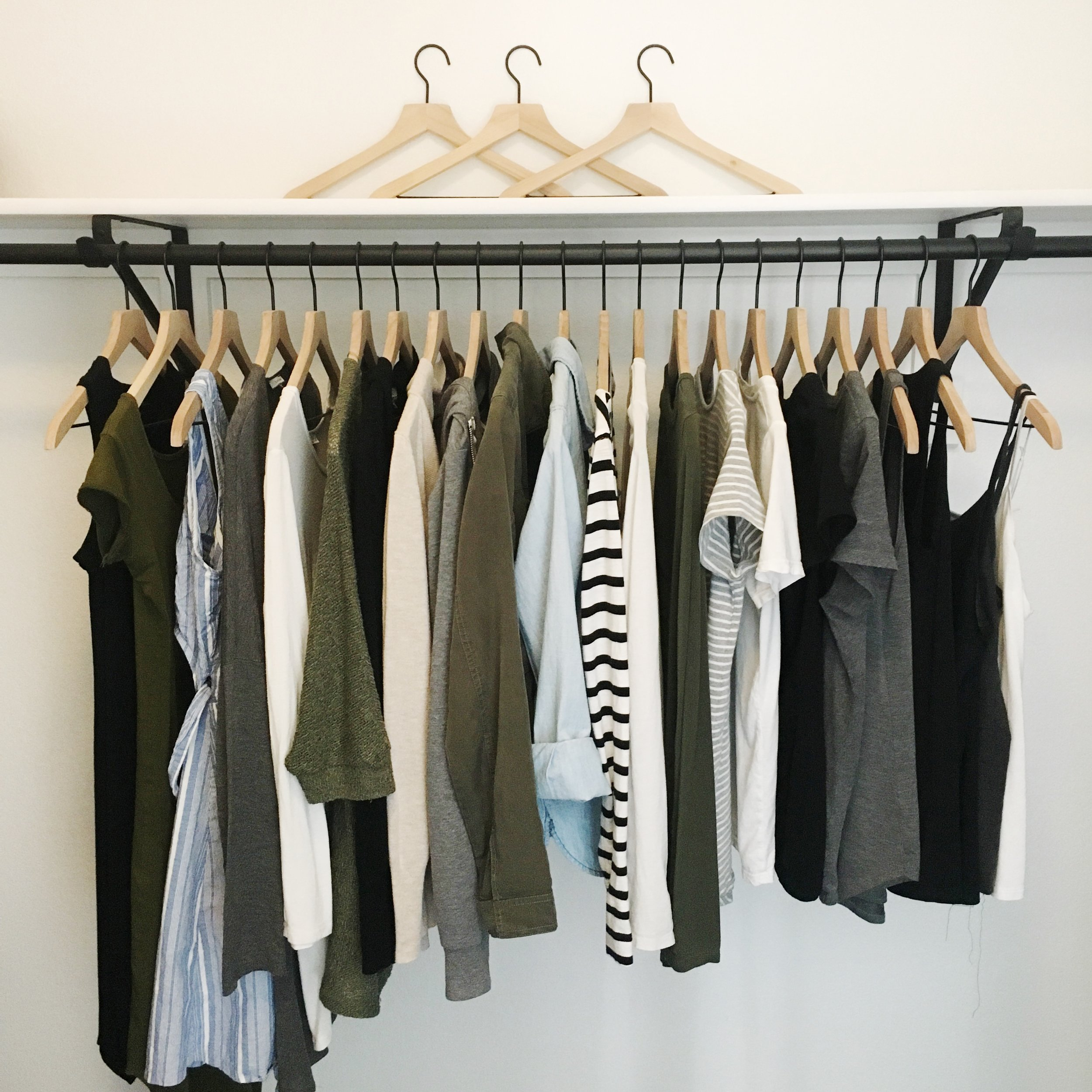 My summer capsule wardrobe, minus pants/shorts which are all stored in a drawer.