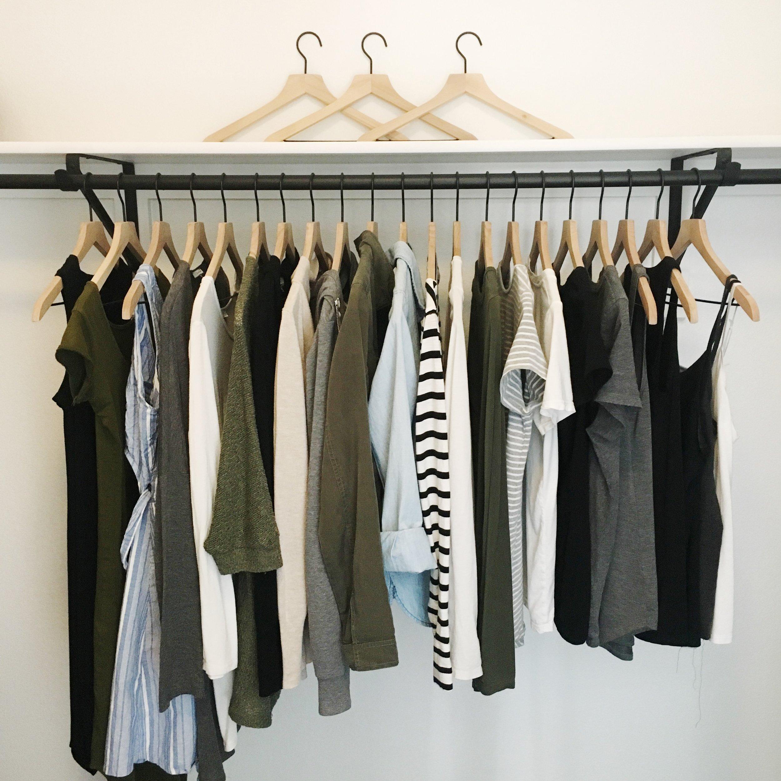 Capsule Wardrobe clothing in organized closet that sparks joy