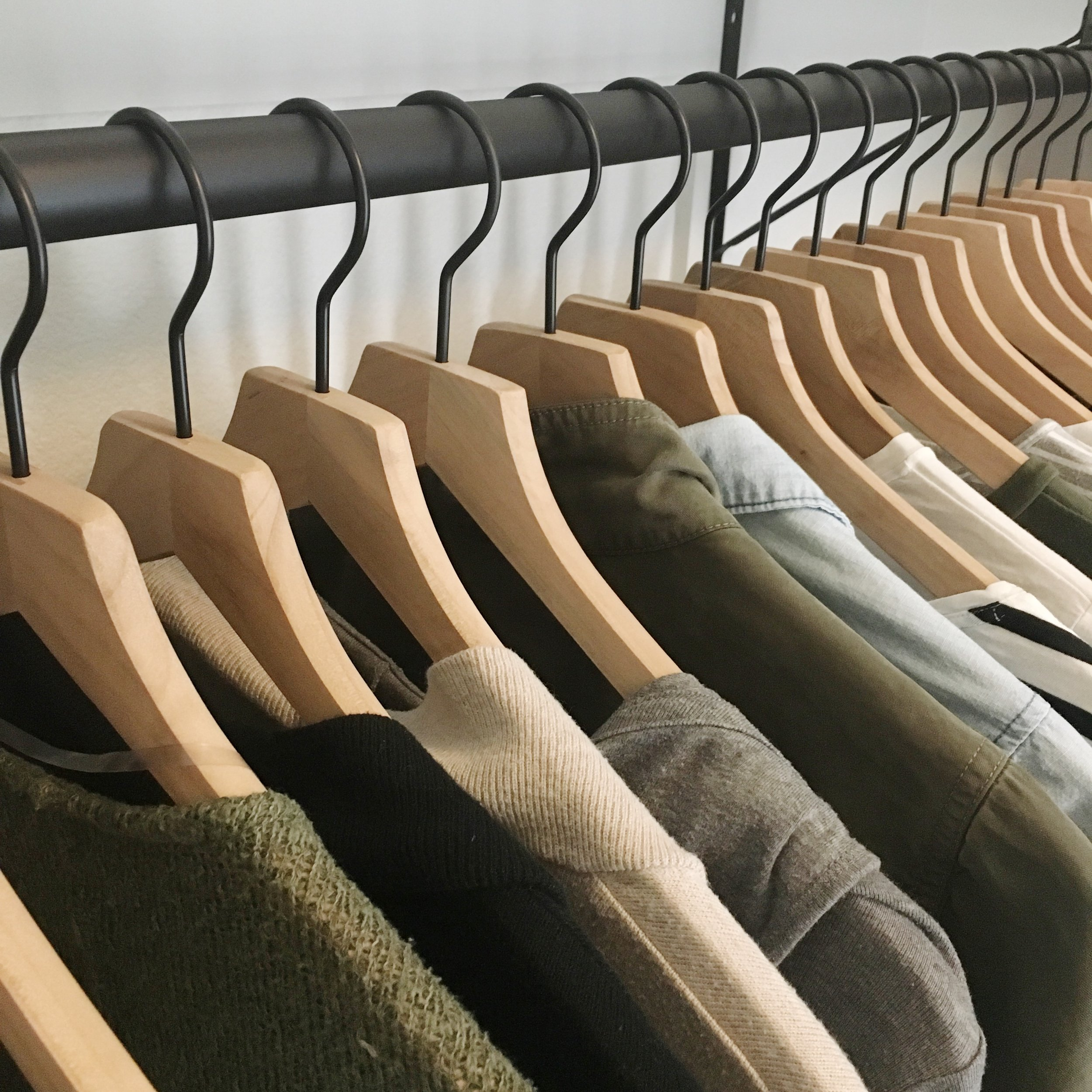 Capsule Wardrobe clothing in organized closet with ethical brands & clothing