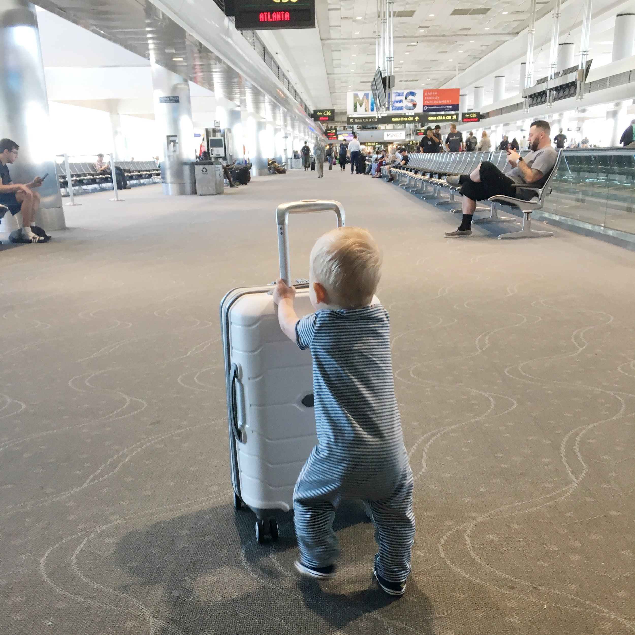 Tips for traveling & flying with a baby; Samsonite luggage