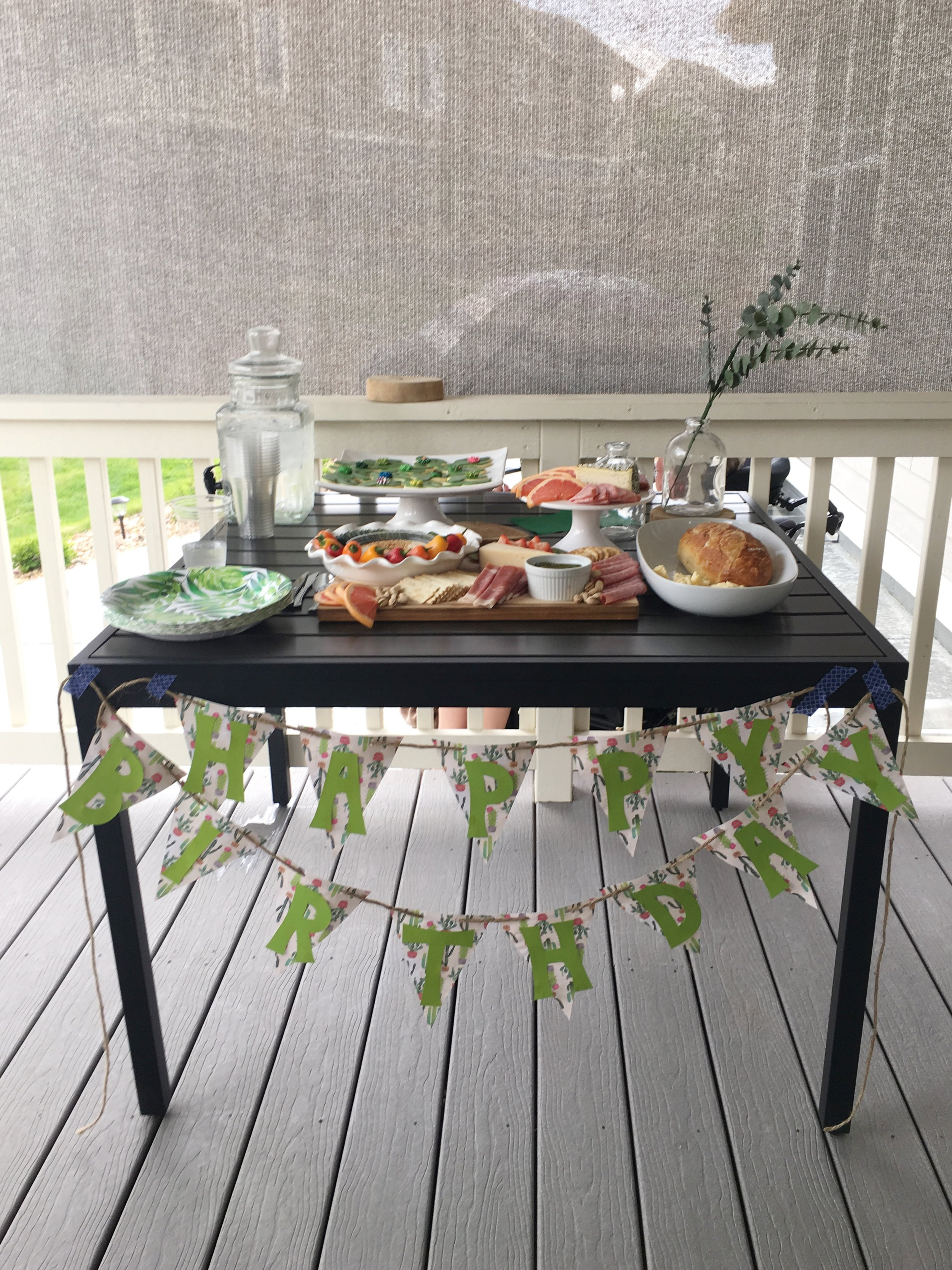Table setup for birthday party; grazing board & sugar cookies