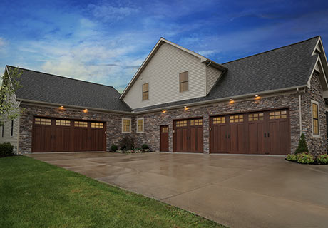 CANYON RIDGE® COLLECTION LIMITED EDITION SERIES - Beautiful and unique, Canyon Ridge® Limited Edition Series carriage house doors are constructed with an energy-efficient, Intellicore® insulated steel base and finished with faux wood composite cladding and overlays. The appearance is that of authentic swing-out doors but with the convenience of modern, upward operation.