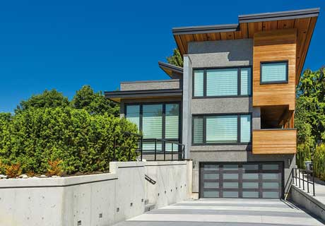 CANYON RIDGE® COLLECTION MODERN SERIES - Canyon Ridge® Modern Series faux wood garage doors are constructed from a durable, low-maintenance, composite material that won't rot, warp or crack.