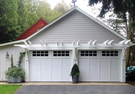 GRAND HARBOR® COLLECTION - When budget is the deciding factor, this low-maintenance, insulation-optional steel frame carriage house style garage door combines clean lines and classic charm to provide a popular style at a great value.