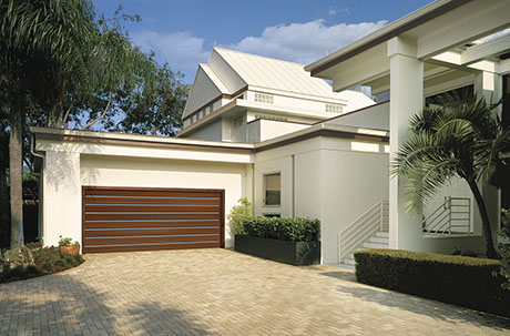 RESERVE® WOOD COLLECTION MODERN SERIES - Clean lines and simple forms let the beauty of natural wood stand out. Clopay's versatile Modern Series lets you mix materials, shape and tone to create a stunning contemporary garage door that blends beautifully with other woods and materials on your exterior.