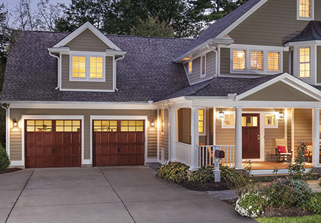 RESERVE® WOOD COLLECTION SEMI-CUSTOM SERIES - Authentic handcrafted carriage house designs combine historical charm and character with the convenience of automatic overhead operation. A natural wood carriage house door is the kind of door that gets people talking. Six carriage house designs in three wood species and multiple top section/window panel designs that can be mixed and matched, painted or stained, to complement any architectural style and color scheme.
