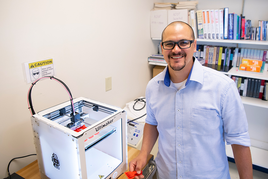 Graduate student, Diego, at WSSU is working with Associate Professor, Elizabeth Fain, to create occupational therapy tools with 3D printing.
