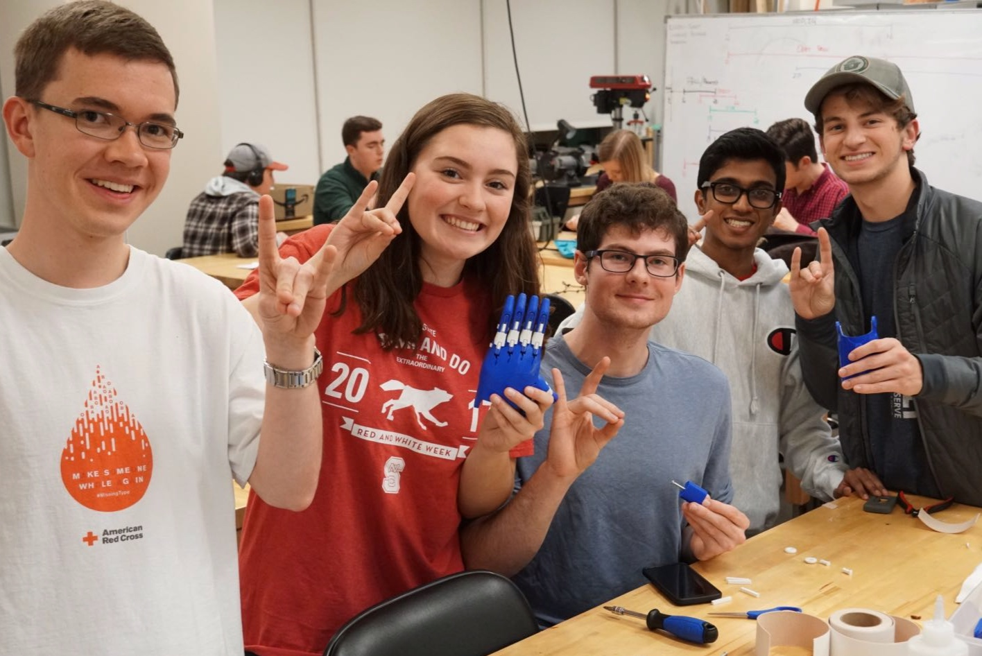 Students in the North Carolina State chapter work together to assemble 3D printed prosthetic devices.