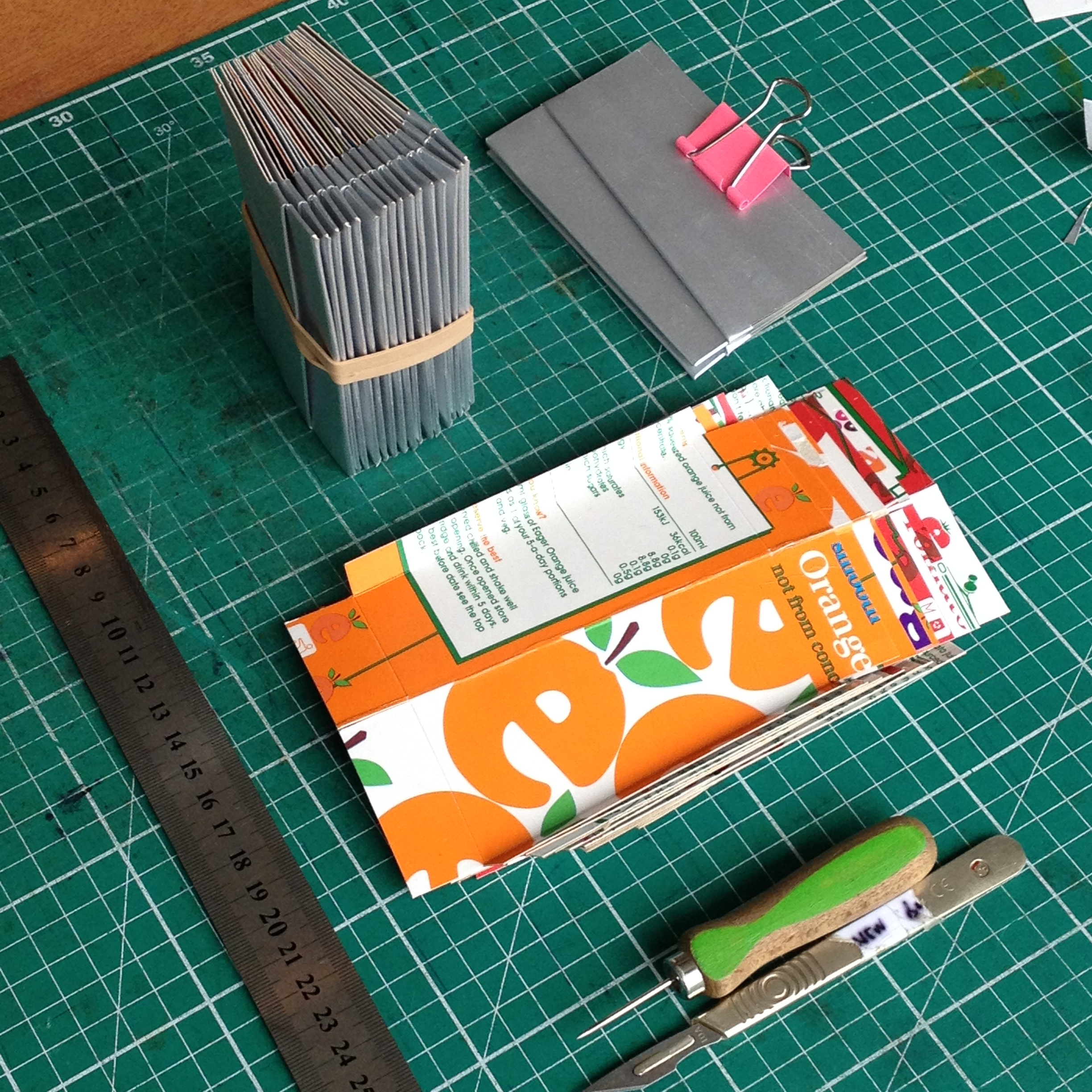 Components for the card holders scored, cut, folded and assembled ready for machine stitching.