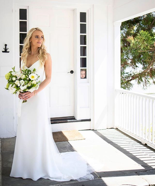 When the flower girl photobombs your bridal portraits