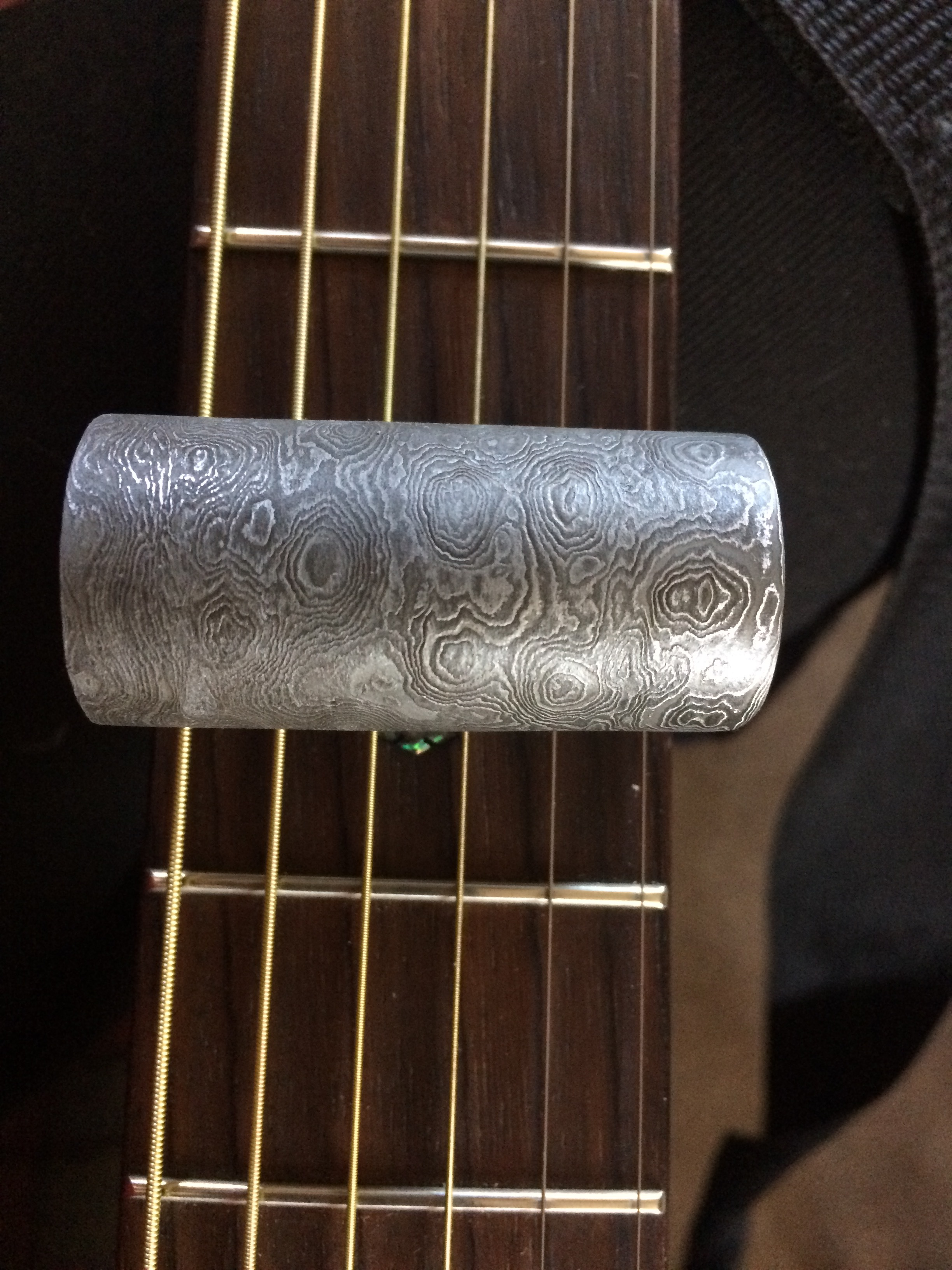 "A ""damascus"" or pattern welded guitar slide."