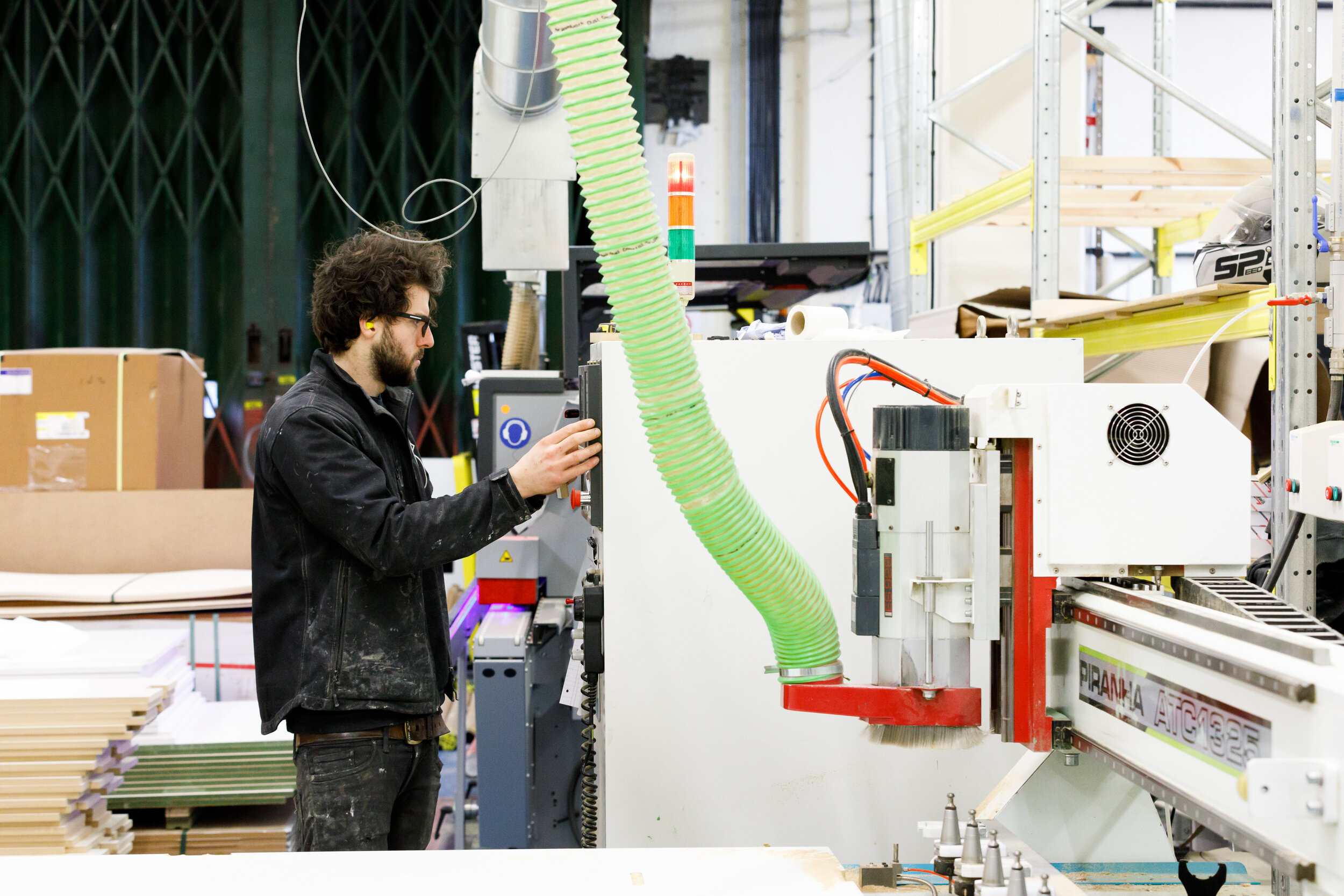 - Workshop manager Rich programming the CNC machine