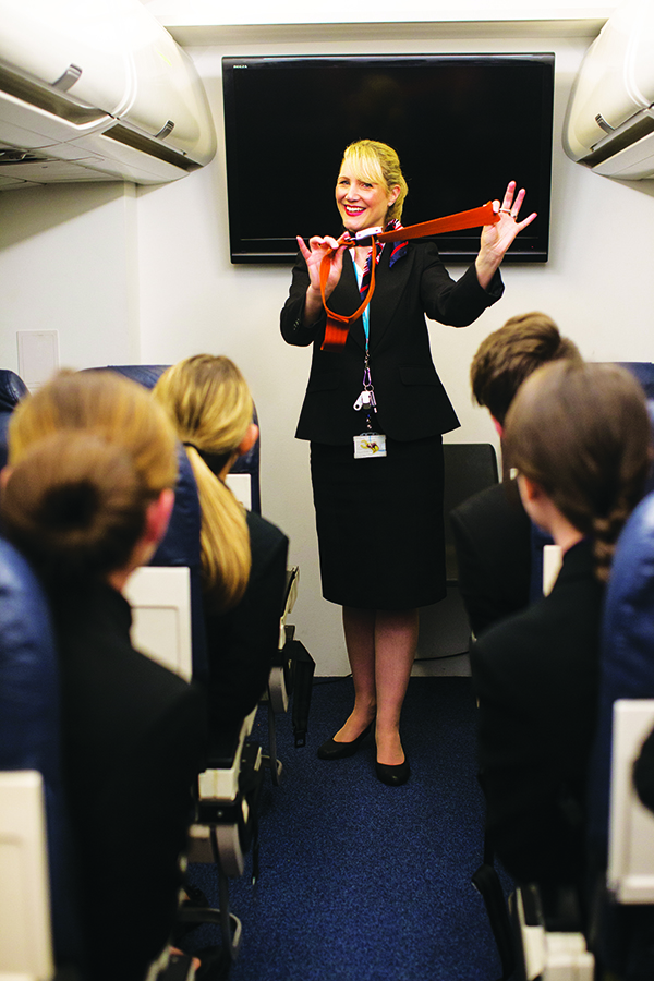 Louiza taking her class through the pre-flight safety demonstration