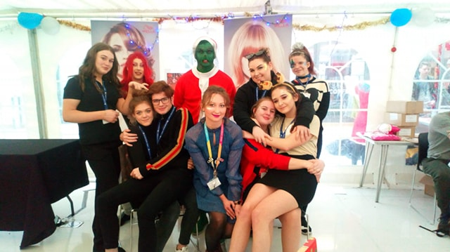 Celina and her make-up students after making up the Grinch at the Christmas Fair in 2108.