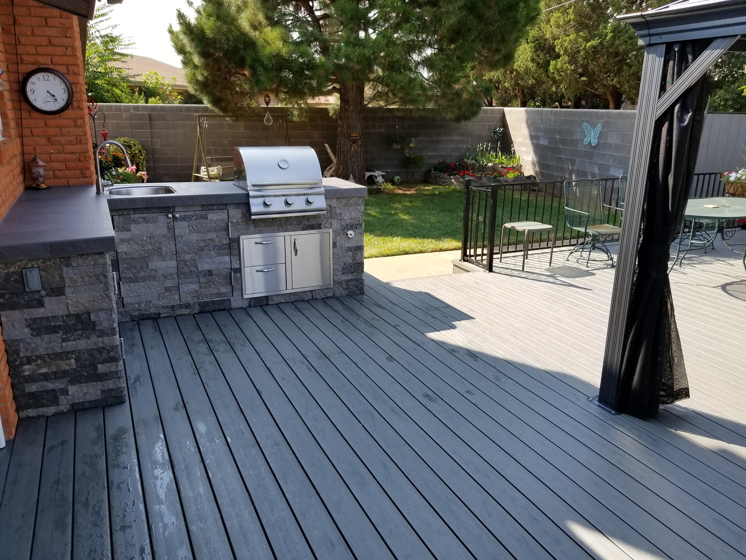 - Composite Decking SystemsRedesign your backyard into a paradise with a brand new deck. We also can build outdoor kitchens and pergolas to entertain guests.