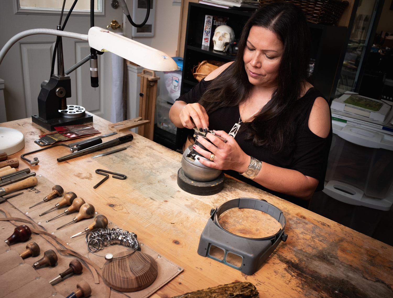 Phyllis working on jewelry