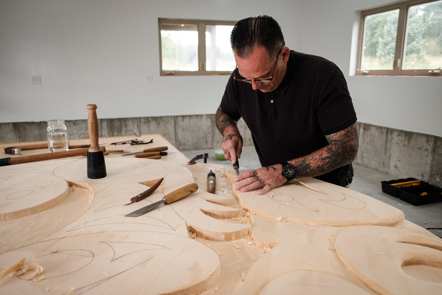 Drew working on a carving