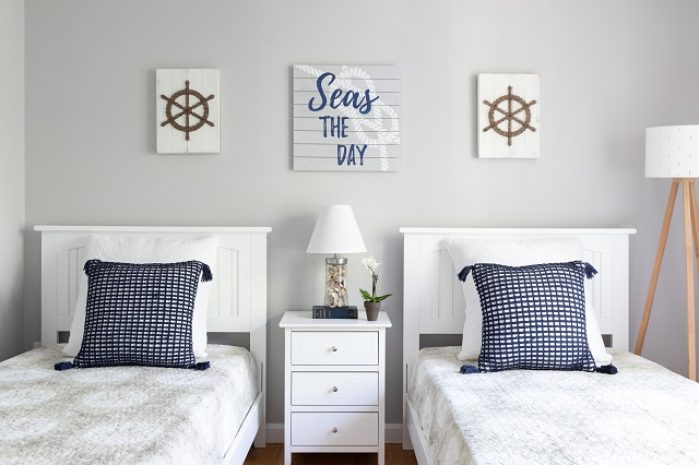 Cape Cod guest bedroom painted in Benjamin Moore AF-690 Metropolitan, white furniture and navy grid accent pillows