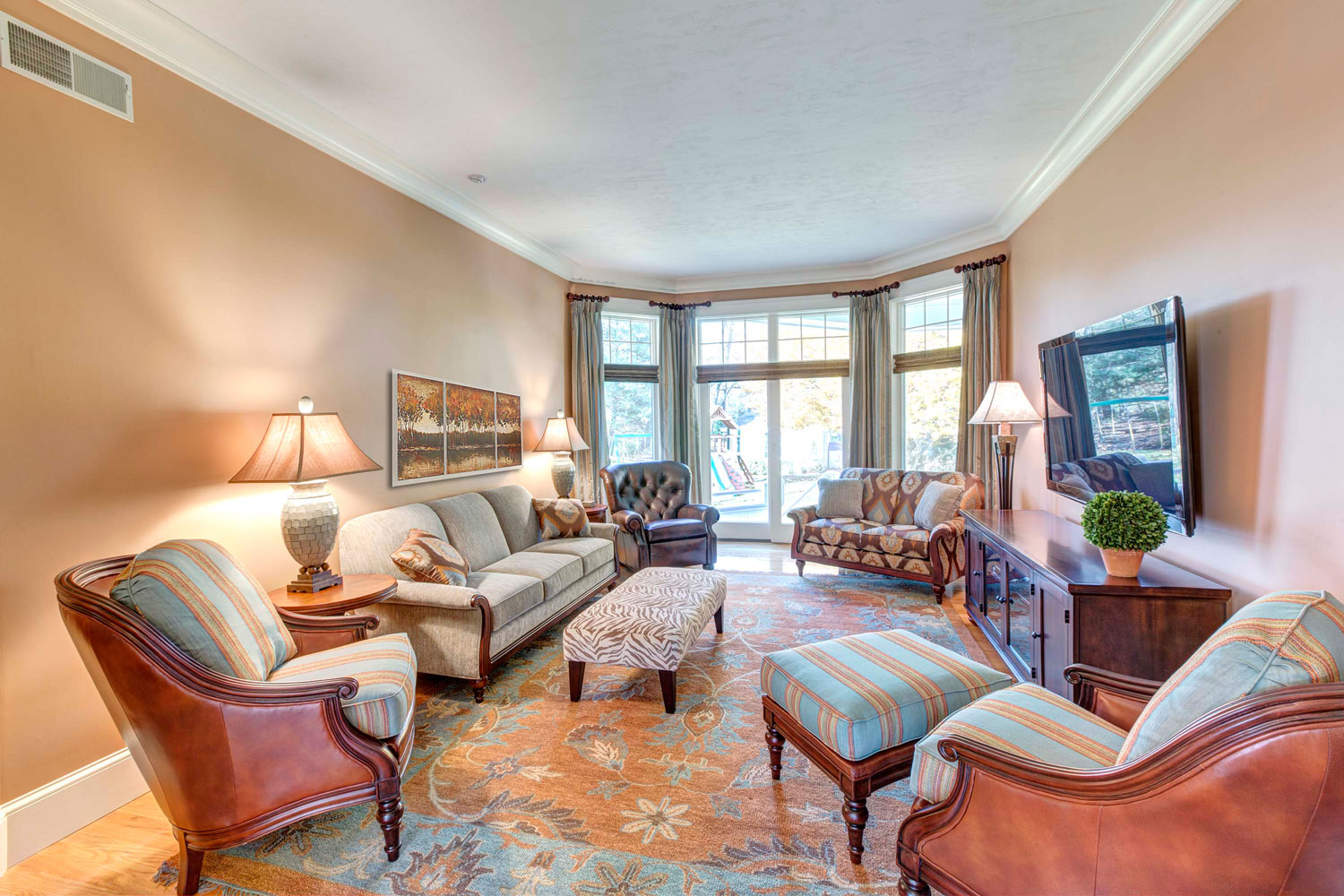 The sitting room has an Akbar hand knotted oriental wool rug and Fairfield Chair custom designed furniture.