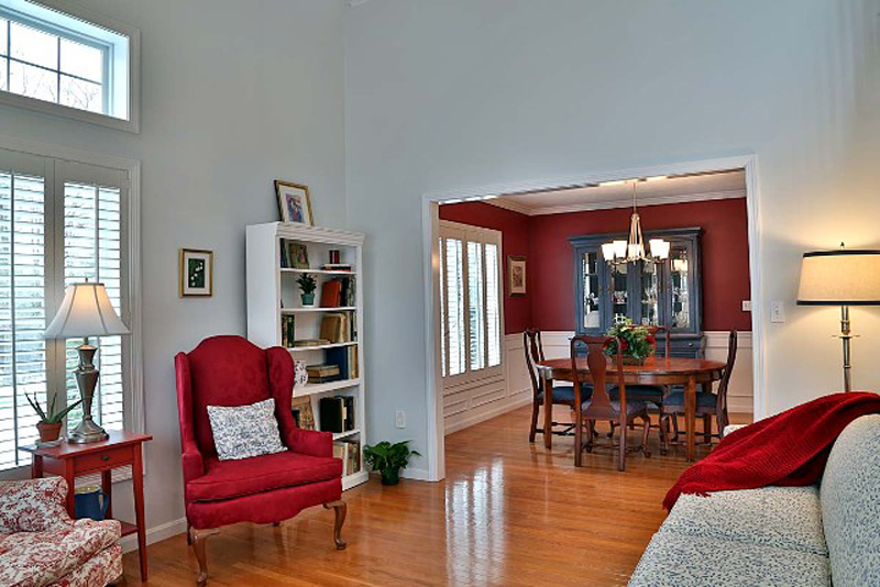 The living room wall color was changed to soft white with a hint of blue from a French blue.