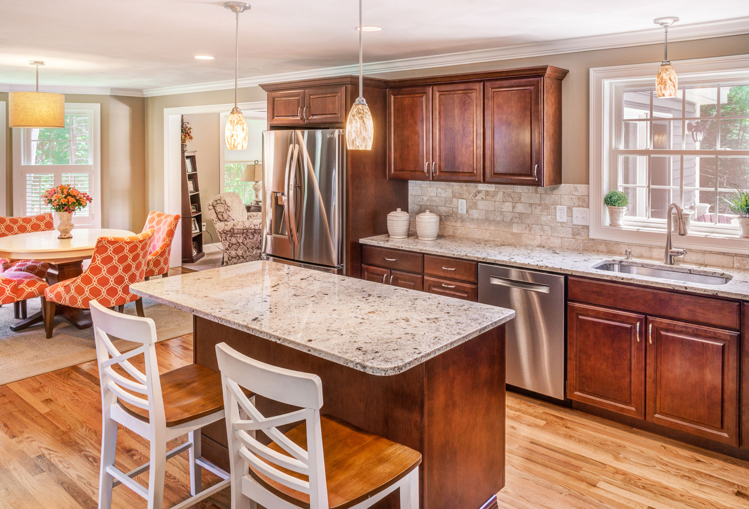 This kitchen has new golden beach granite countertops and tumbled stone backsplash and the appliances are by Bosch.