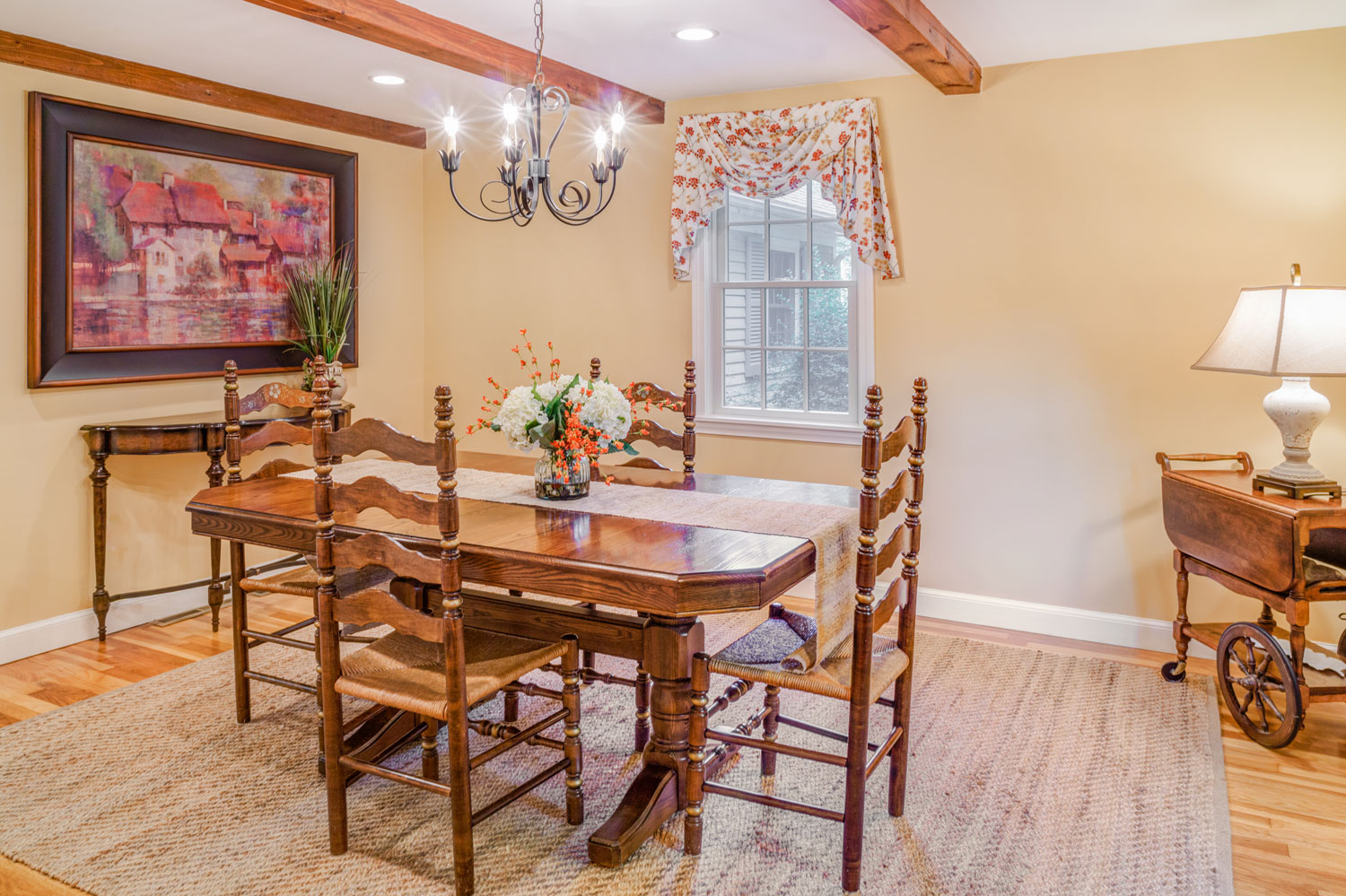 The redesign used the homeowner's existing colonial dining table and chairs.