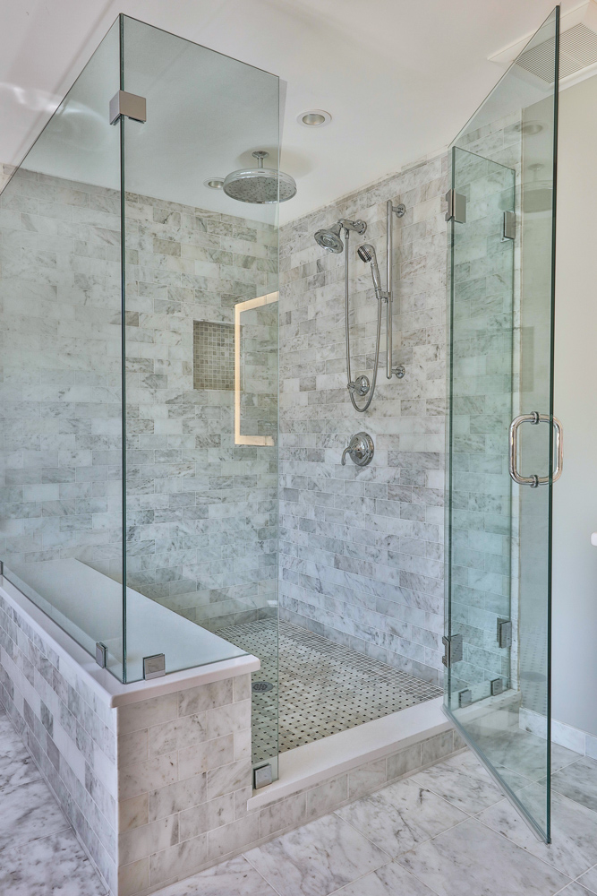 The shower door enclosure is a three-quarter inch glass frameless with chrome hardware.
