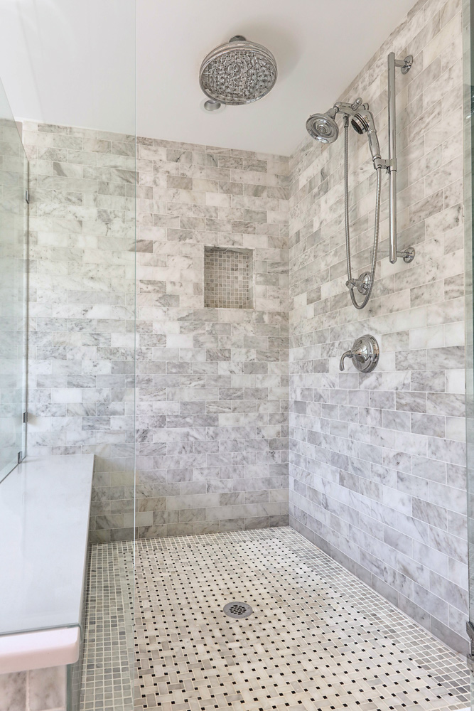 The 4 x 4' walk in shower also incorporated a bench seat in White Zeus Silestone.