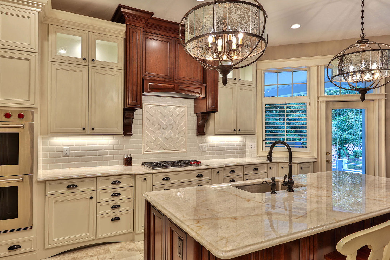 This kitchen has new golden beach granite countertops and tumbled stone backsplash.