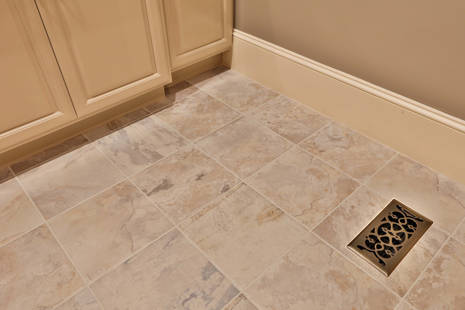 Tile flooring in the laundry room and bath.