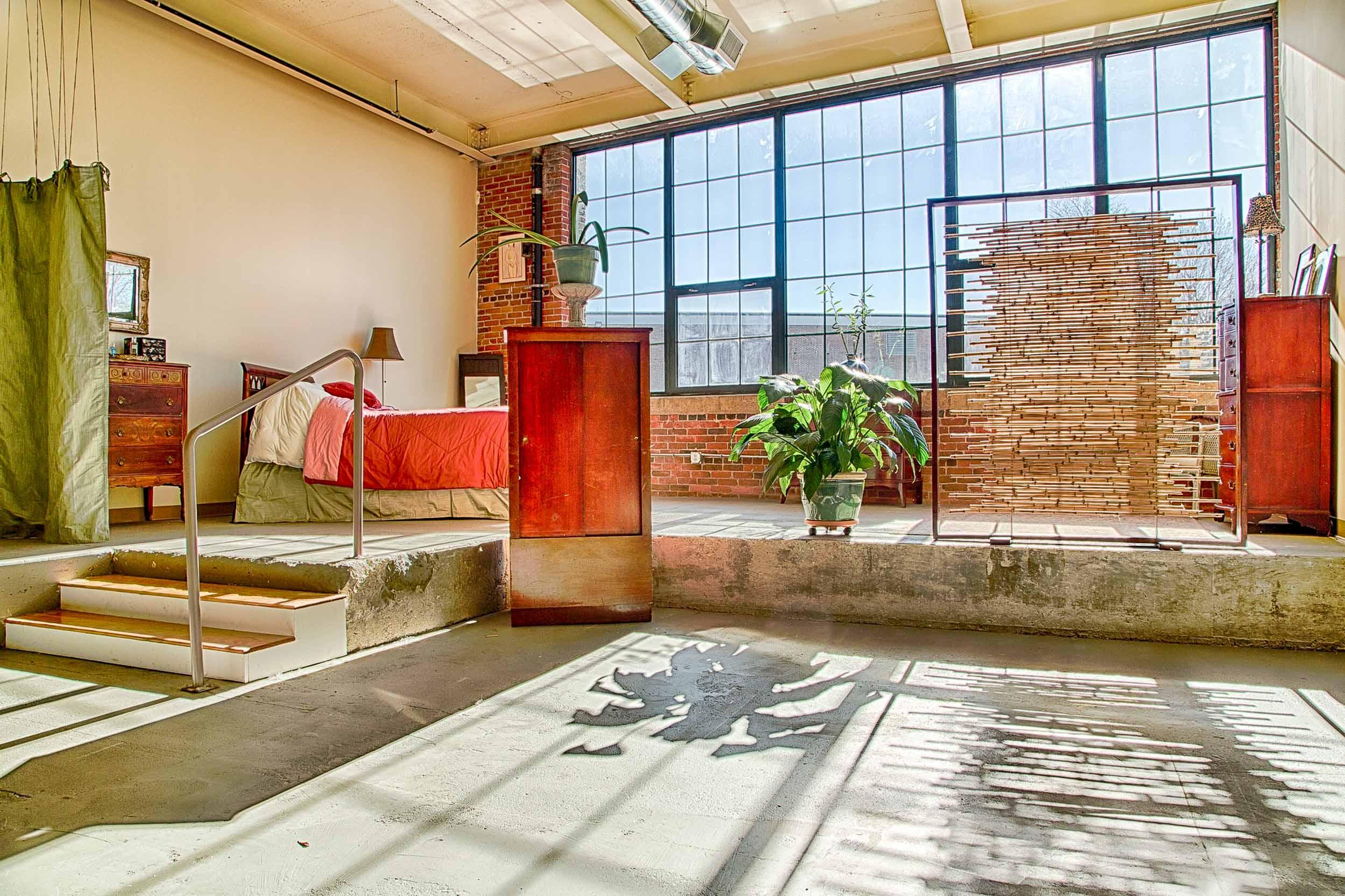 A bright spacious artist's loft interior design. Lowell, MA.