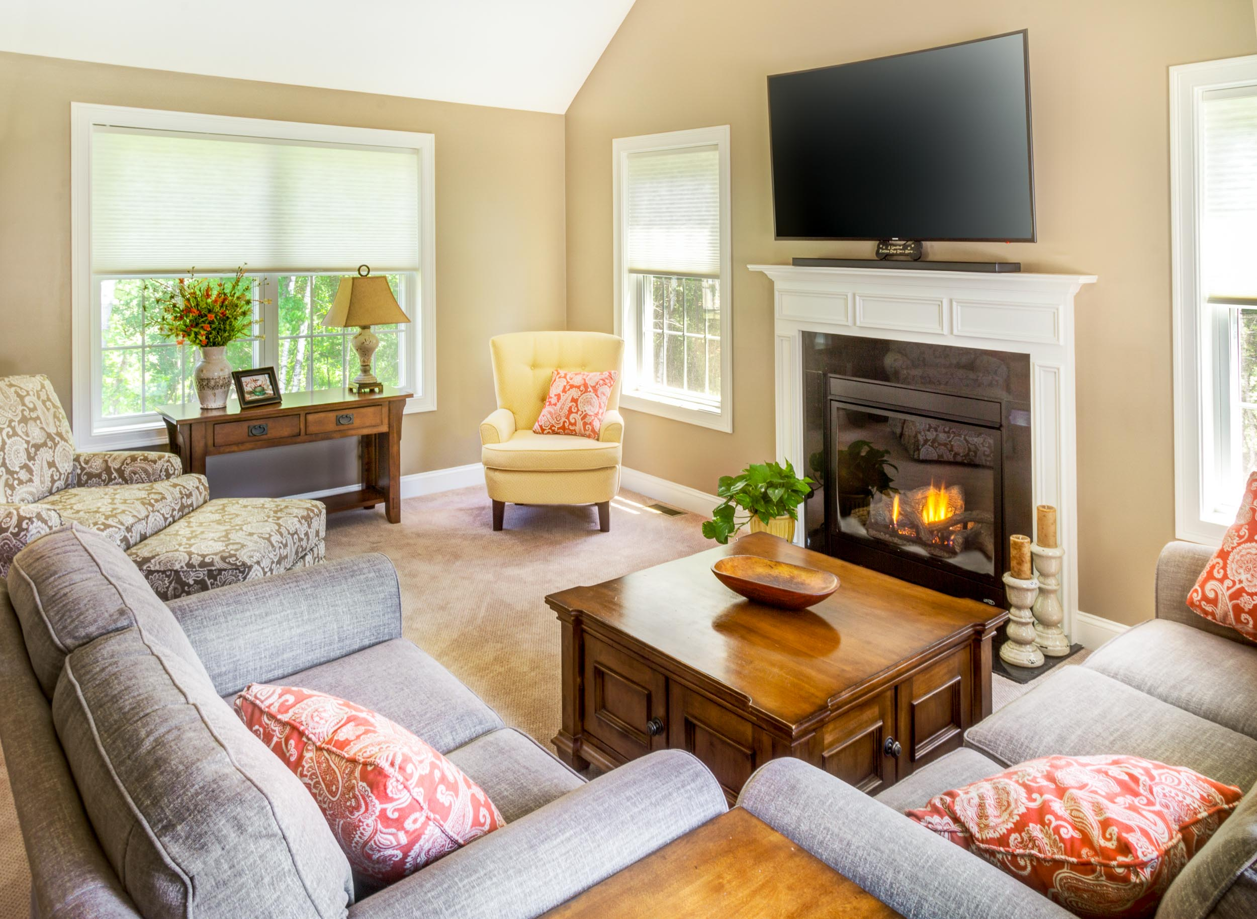 The family room wall color is Alexandria Beige. The sofa is skirted and the love seat is a sock arm style.