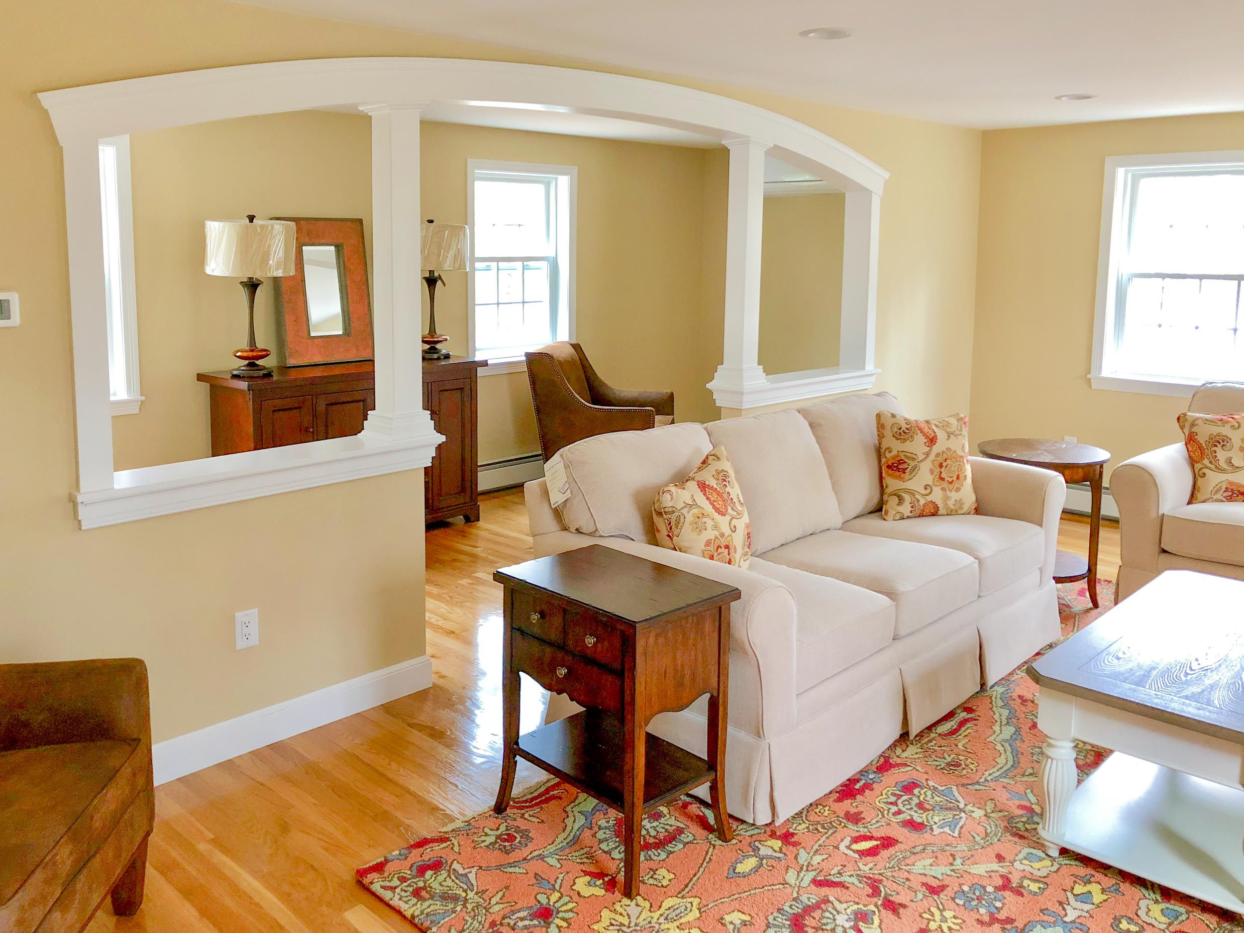 Everything in this family room was custom from window treatments, sofa's, pillows, and the suede leather chairs.