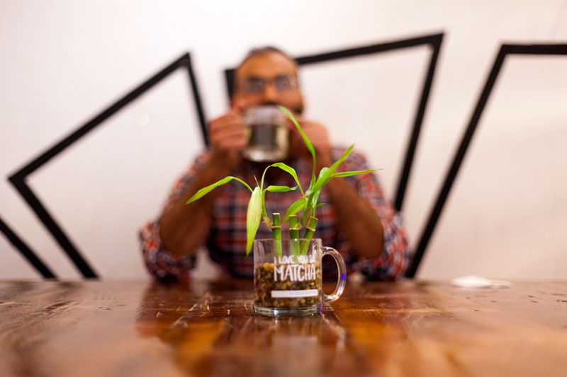 "ELI TEA BAR PARTNERSHIP - DKBCo brews exclusively with Eli Tea Bar in Birmingham, MI. Tea master and botanist, Eli Majid, collaborates on tea blends for our signature kombucha flavors. In 2017, Eli won an ""Eater Young Guns"" national award for his tea originality and influence."