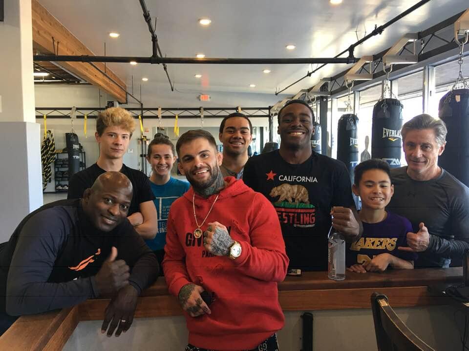 Quincey Clark, Liam Dunn, Kiernan Dunn, Cody Garbrandt, Songe Eke, Denzel Mabry, and Kevin Dunn at Ultimate Fitness.