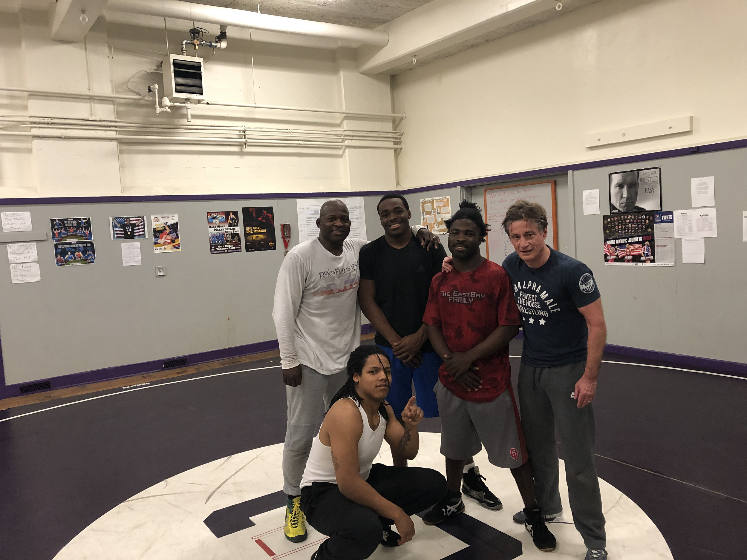 Quincey Clark and Kevin Dunn with Castlemont and Oakland Tech Wrestlers in the Castlemont Wrestling Room.