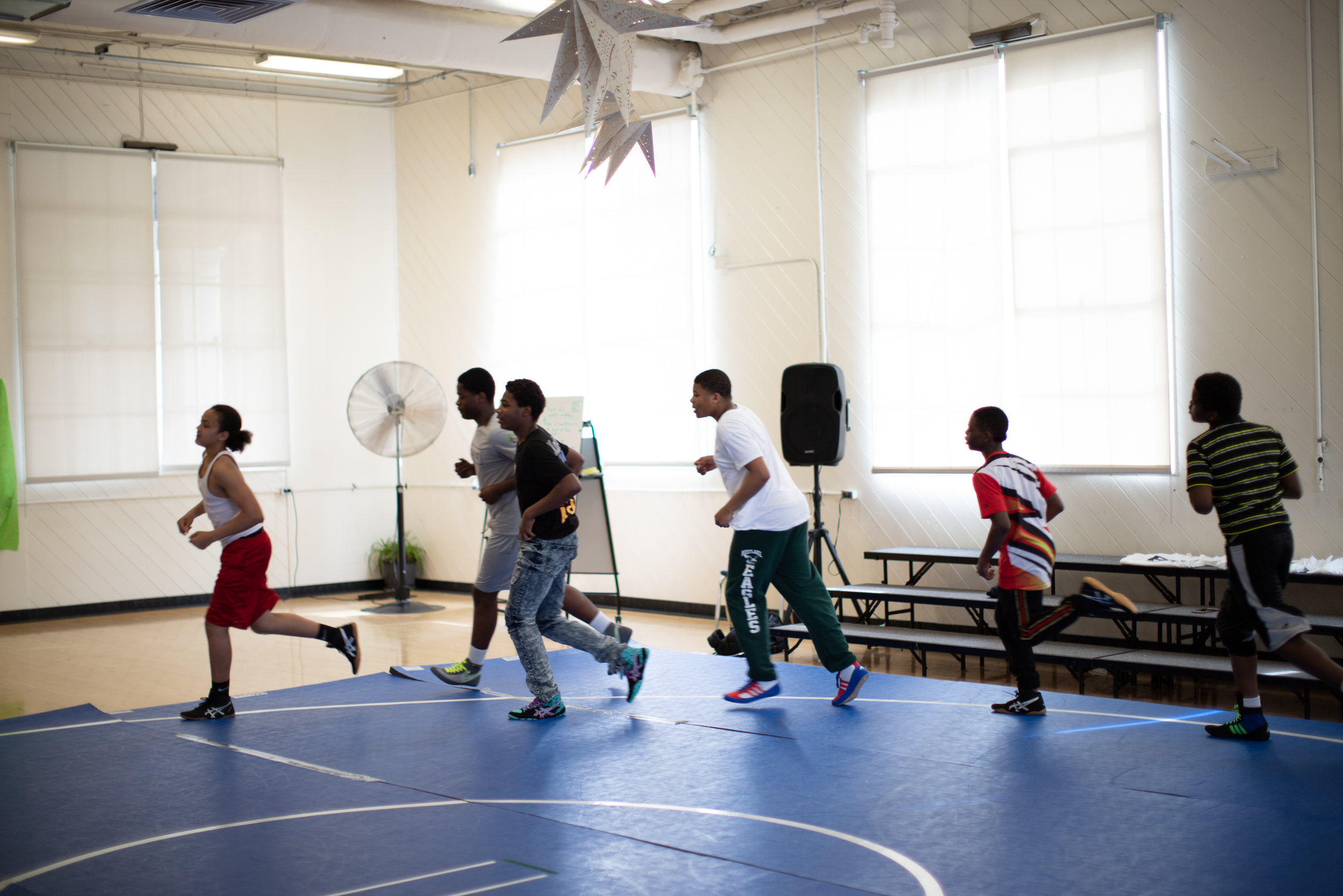 Some of the Westlake wrestlers warming up to start practice (photo by Leonardo Flores).
