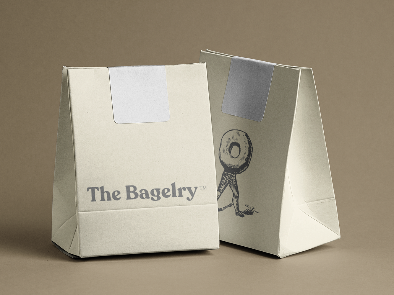 paper-bag-mockup-featuring-two-paper-bags-over-a-flat-surface-a6771.png