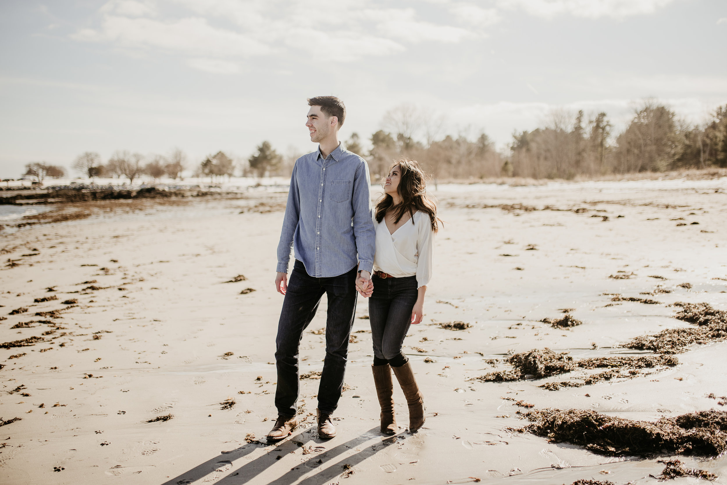 Love this pose, stand together but only one look at the other..(newcastle NH beach engagement shoot)