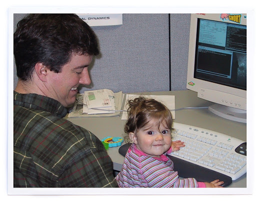 At Sourcefire's first office in Columbia, MD with Molly on my lap. February 2002.