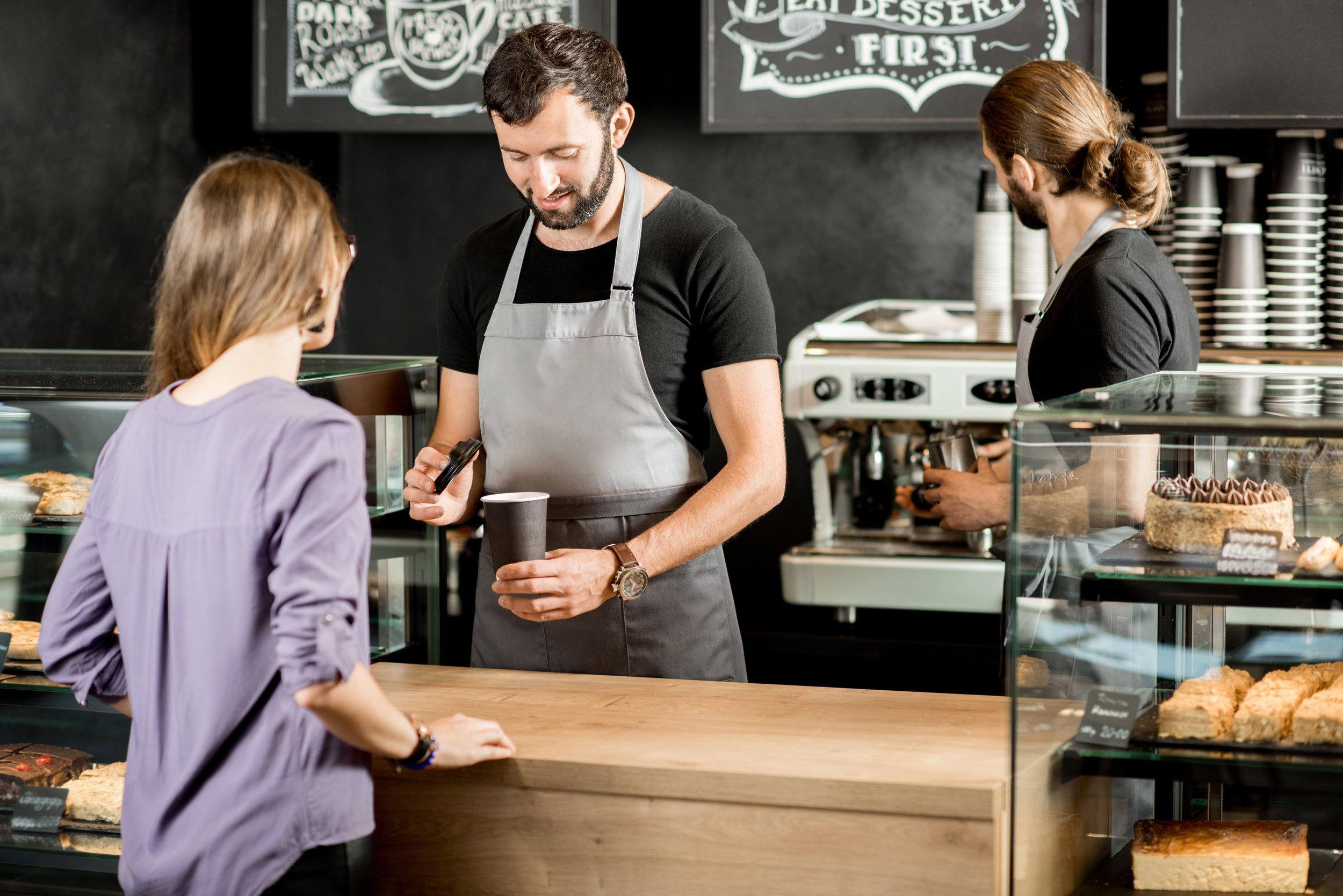 barista serving customer.jpeg