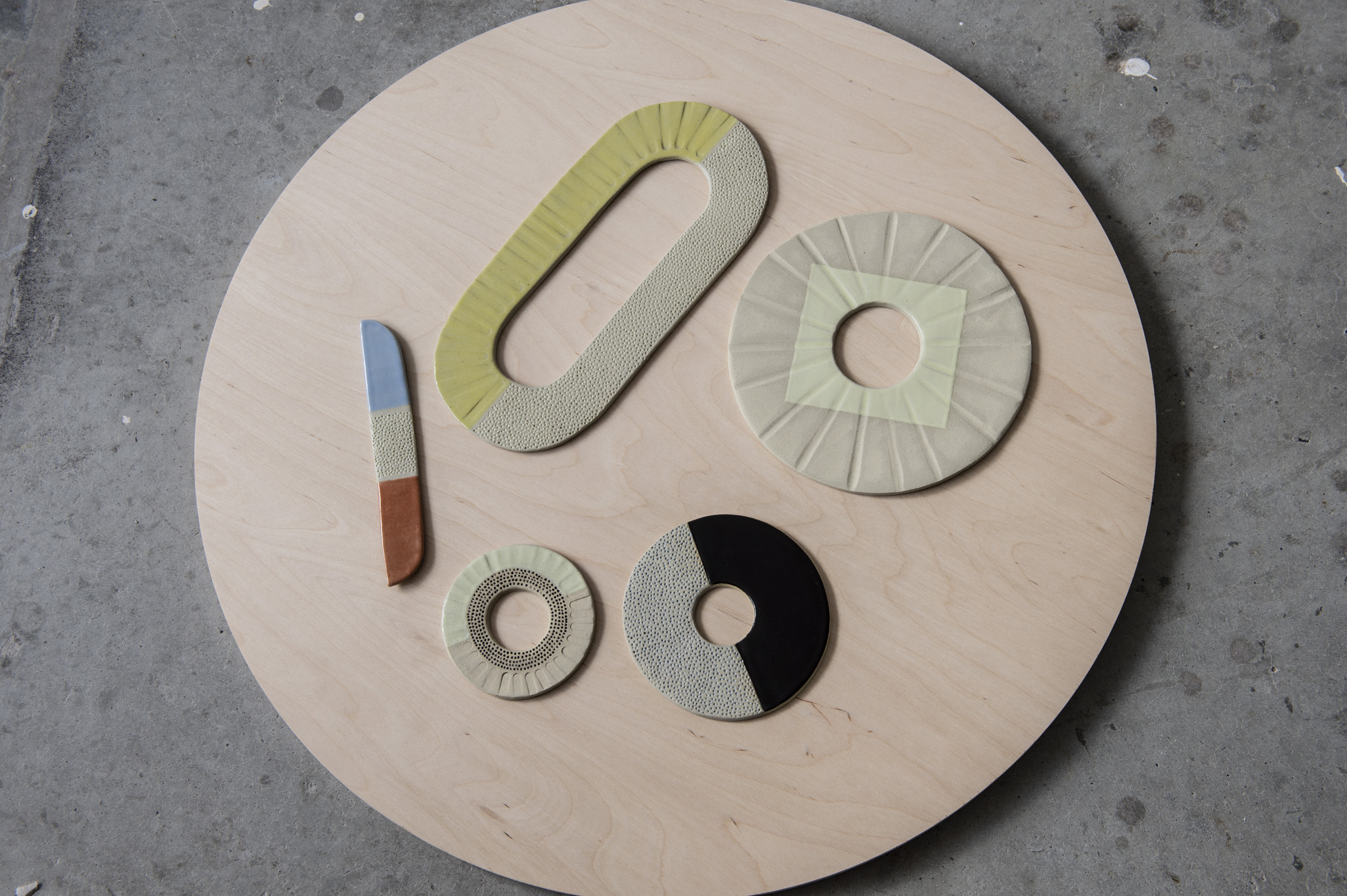 "Ceramic Discs and one ""Knife""  Clay and glaze September 2018"
