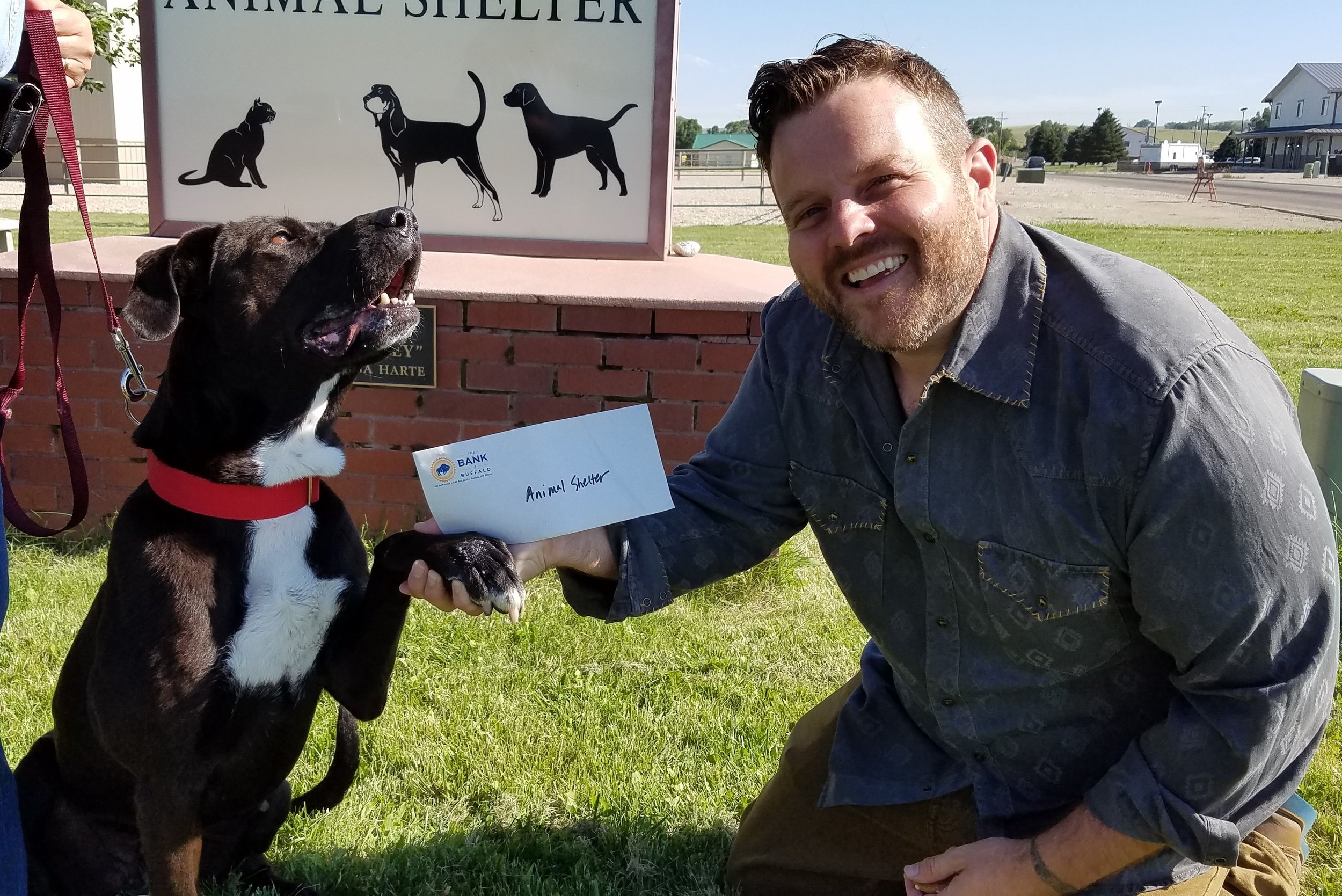 What a fantastic  Longmire Days ! Our fantastic friend and supporter  Adam Bartley  stopped by last week to drop off a donation into the waiting paw of Lilly, one of our adoptable pooches! Thank you so much Adam, from every critter here at the shelter!