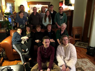 My family after the launch. From front to back: Twins: Ben and Madel (ages 17), Ramon (13) with his dog Mojo, Marnie, Ev, my sisters Jan and Lillis, Greyson (12), nephew John, Jackie, Maeve (9), Matthew, and Carlos.